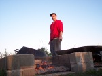 Chef Duda inspects the fire pit